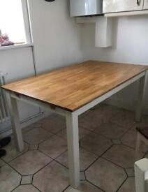 Oak dining table with cream leg