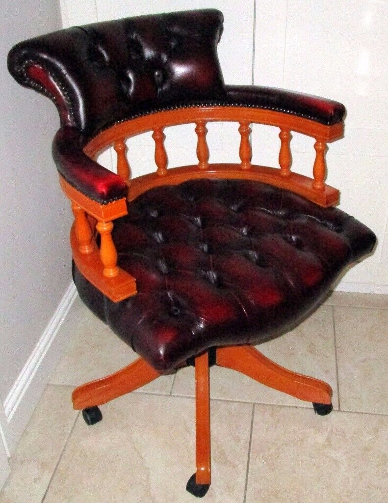 Reproduction Ox Blood Captains Chair With 360 Swivel And Tilt.