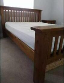 Solid oak double size bed frame with bedside cabinets excellent condition.