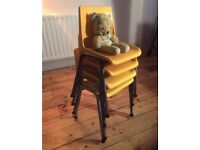 4 yellow stackable children's chairs