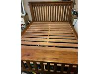 Robust solid oak either king or double bed frame by Bensons for beds great condition