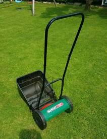 Push along lawn mower