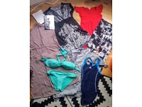Bag of maternity wear containing 27 items for sale.