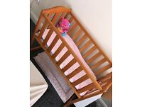Baby crib and baby girls Moses basket with stand and crib comes with sheet.