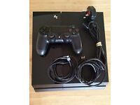 PS4 console with controller & 4 games