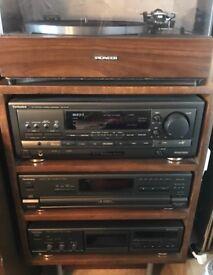 Pioneer turntable, speakers, super woofer, cassette deck, AV control, 5 disc changer, remote control