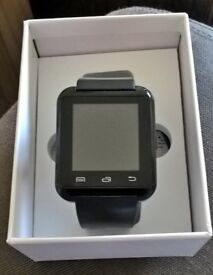Pandaoo Bluetooth fitness smart watch in black, with USB cable and manual