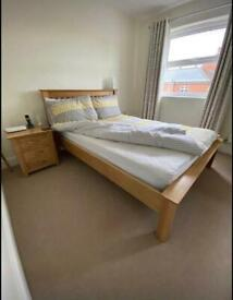 Solid oak double size bed frame with bedside cabinets excellent condition, mattress is £80