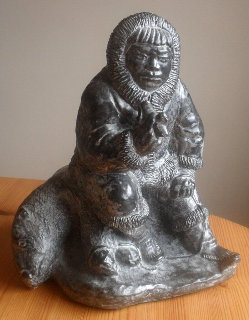 Al wolf eskimo with seal large soapstone carving in
