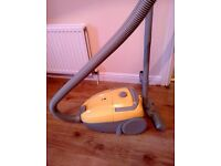 Bagged Cylinder Vacuum Cleaner / Hoover - Excellent condition. 5 vacuum bags free with it.