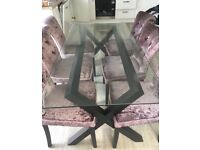 Glass dining table only, doesn't include the chairs. In great condition. Buyer to collect