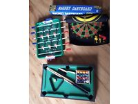 Table top pool table, football and magnetic dart board.