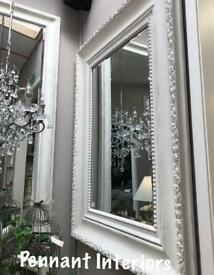Antique white wall mirror with rose design