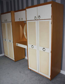 Schreiber double wardrobe with central cupboard section with mirror.