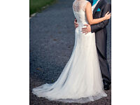 Beautiful wedding dress, size 10 unaltered cleaned