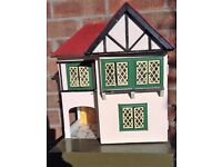 Much-loved DOLLS HOUSE. 1930s style frontage. Open front garage or covered patio area.