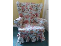Wingback armchair with loose cover in excellent condition