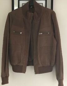 Brown leather jacket size 16 ( but would fit a 12/14 ) Worn once
