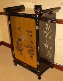 Chinese black lacquer gold leaf cabinet in lovely condition
