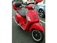 Red vespa GTS 300 super
