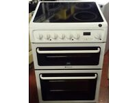 Hotpoint 60 cm wide double oven and grill electric ceramic cooker in white colour