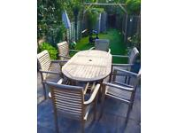 Solid TEAK extendable table & 6 x (stackable) chairs + winter covers
