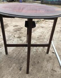 Round vintage solid wood cross-braced coffee table
