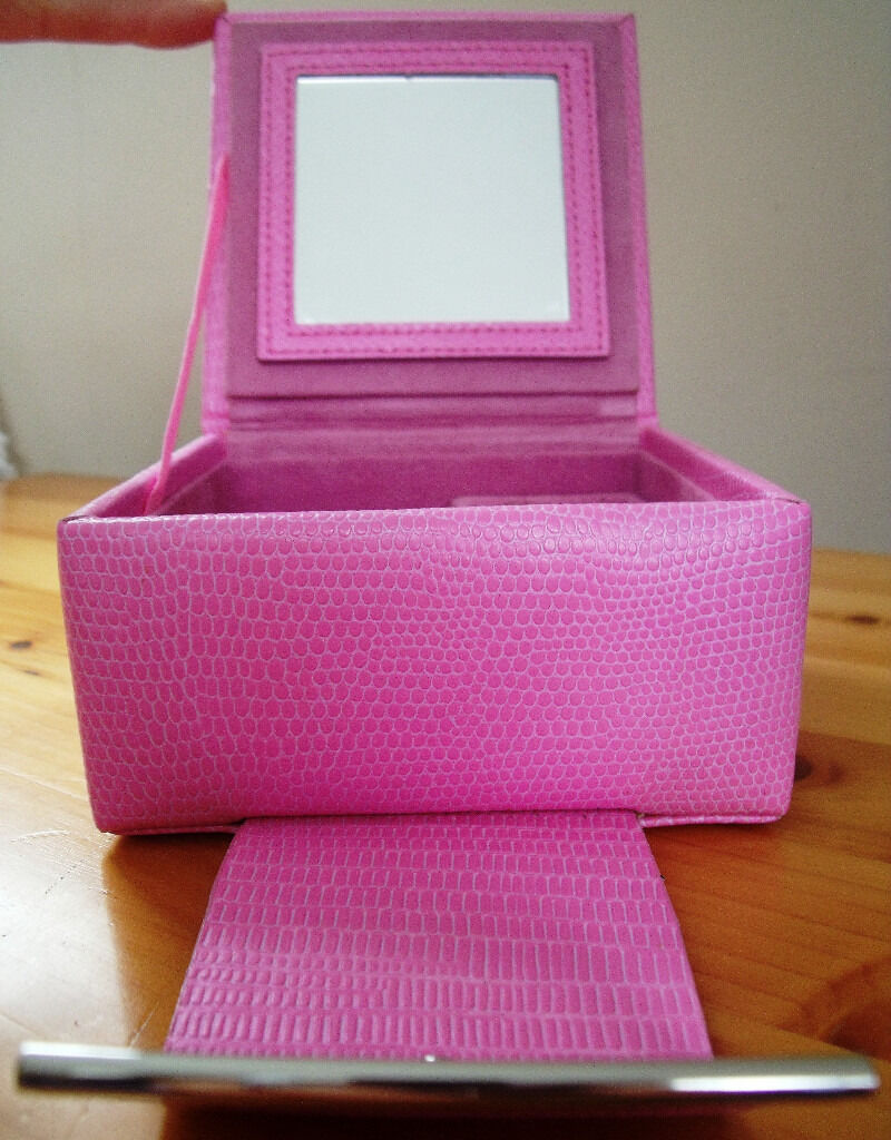 Jewellery box by Dulwich designs pink snake skin effect leather/mirror inside lid5 ovnoin Romney Marsh, KentGumtree - Jewellery box by Dulwich designs pink snake skin effect leather. Good condition, hardly used. ONLY £5 ovno. A beautiful, compact jewellery box covered in pink snake skin effect leather and lined with pink suede. There is a very useful mirror in the...