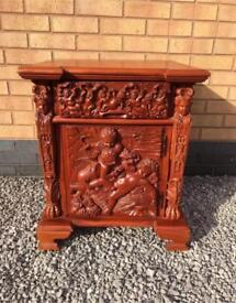 Hand carved cherub cupboard
