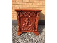 Hand carved cherub cupboard