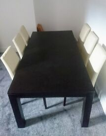 Solid Wood Extending Dining Table and Six Real Leather Matching Chairs