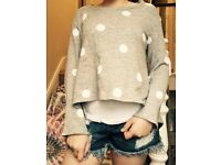 Girls size 10 grey funky shaped jumper with white polka dots