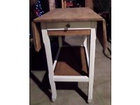 Delightful fold down table with drawer