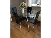 Glasss dinning table with chairs