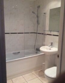 Complete bathroom, steel bath shower over, wash basin and toilet shower cubicle and shower .