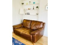 DFS 2 seater brown leather sofa (used)