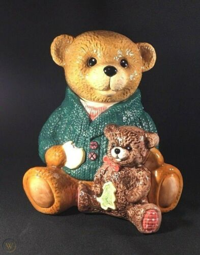 VINTAGE TEDDY BEAR WITH GREEN SWEATER HOLDING A TOY BEAR COOKIE JAR