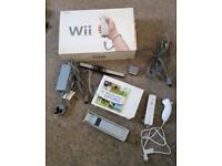 Nintendo Wii with accessories and game
