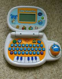 Children learning and music laptop