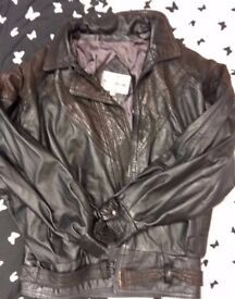 Women jacket: one in leather and one imitation.