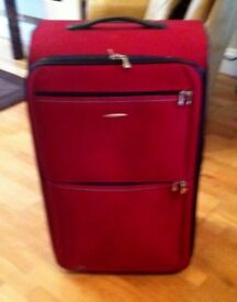 Large TRIPP suitcase with wheels, Red, Used once only.