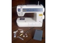 Toyota JS021 Jeans Sewing Machine with Accessories and Instructions
