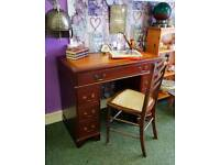 Reproduction desk and chair.