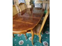 Malaysian teak dining room table and six chairs