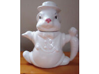 Novelty white rabbit wearing a hat teapot. Carrot handle, pink nose, blacks eyes and eyebrows.