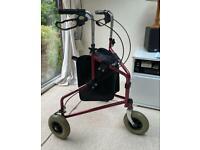 Tri wheeled walking aid