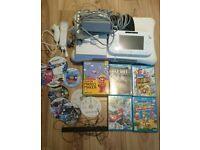 Nintendo Wii U Bundle with controllers, games ( Super Mario, Yoshi, Zelda ) and Wii Fit Board