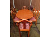 Real Yew Wood extendable Dining table with 8 chairs with red & gold patterned seats good condition
