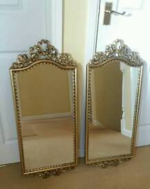 Pair of ornate gold mirrors