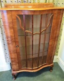 Small bow fronted display cabinet with key